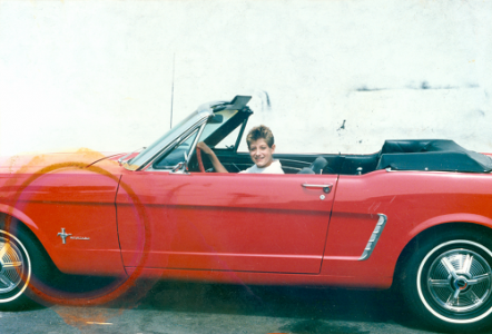 Ryan White  in a red convertible